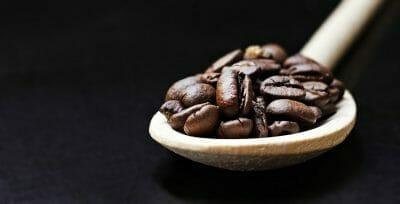 Caffeine Coffee Beans In Spoon